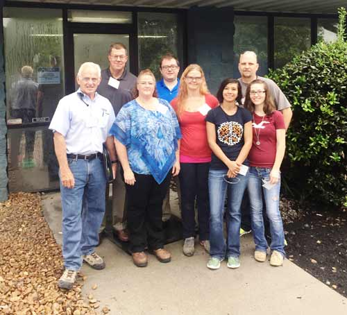Technicians from manufacturing and engineering join Moeller sales team members for a tour of a customer facility.